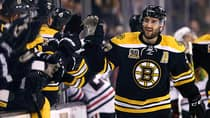 Bruins' Patrice Bergeron is congratulated by teammates after his goal against the Blackhawks Thursday, March 27, 2014, in Boston. (Charles Krupa/The Associated Press)