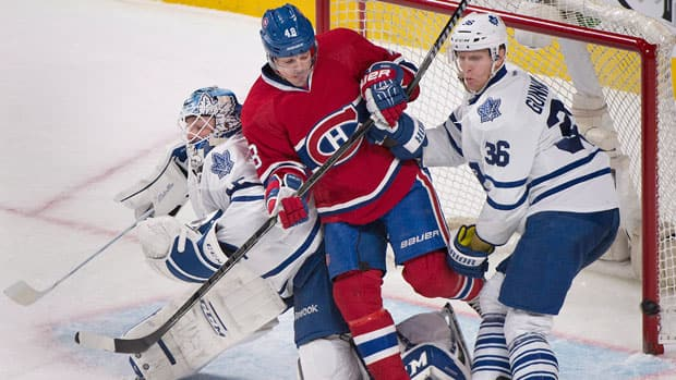 Montreal Canadiens forward Daniel Briere, centre, is sandwiched between Toronto Maple Leafs goaltender Jonathan Bernier, left, and Carl Gunnarsson during the second period Saturday. (Graham Hughes/Canadian Press)