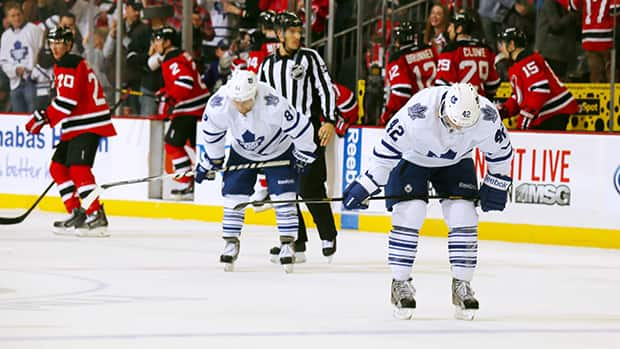 Tyler Bozak, right, and Phil Kessel of the Toronto Maple Leafs react after losing to the New Jersey Devils at the Prudential Center on March 23, 2014 in Newark, New Jersey. (Adam Hunger/Getty Images)