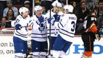 Tyler Bozak (42) of the Toronto Maple Leafs celebrates his goal with Phil Kessel (81), James van Riemsdyk (21) and Dion Phaneuf (3) on Monday in Anaheim, California. (Harry How/Getty Images)