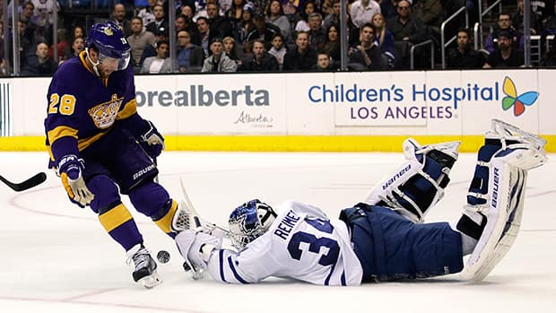 Maple Leafs goalie James Reimer, right, stopped all 31 shots in relief of injured teammate Jonathan Bernier in Toronto's 3-2 win over the Kings in Los Angeles. (Jae C. Hong/Associated Press)