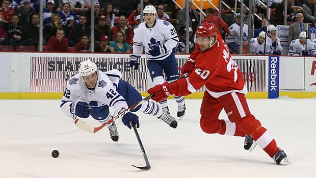 Tyler Bozak of the Toronto Maple Leafs dives to block a shot by Drew Miller of the Detroit Red Wings at Joe Louis Arena on March 18, 2014 in Detroit, Michigan. (Leon Halip/Getty Images)