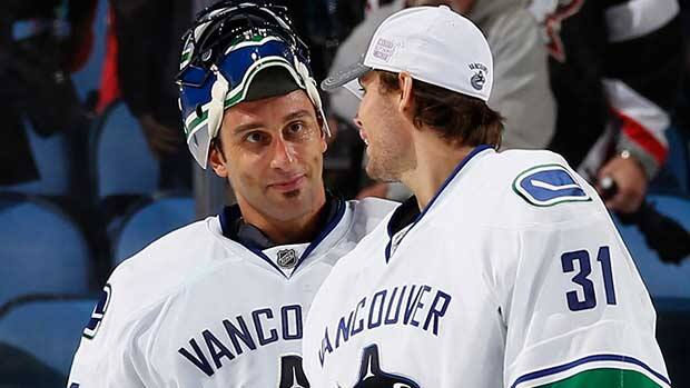Roberto Luongo, left, has been the subject of plenty of trade rumours over the past couple of years, while Eddie Lack, right, may not take over the starting reigns in Vancouver. (Jen Fuller/Getty Images)