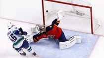 Florida Panthers goalie Roberto Luongo gives up the game winning goal to Vancouver Canucks left wing Nicklas Jensen. (Robert Mayer/Reuters)