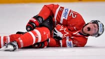 Eric Staal grimaces after a knee-on-knee hit at the world hockey championships in May of 2013. (File/Getty Images)