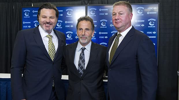 In happier times: Vancouver Canucks owner Francesco Aquilini, left, head coach John Tortorella, centre, and GM Mike Gillis. (Rich Lam/Getty Images)
