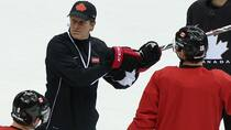 Team Canada head coach Mike Babcock conducts Feb. 10 practice at Bolshoy Arena during the Sochi Olympic Winter Games. (Bruce Bennett/Getty Images)
