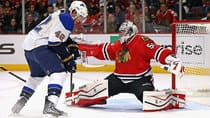 David Backes, left, and the Blues will try to knock off goalie Corey Crawford and the defending Cup champion Blackhawks in the opening round. (Jonathan Daniel/Getty Images)