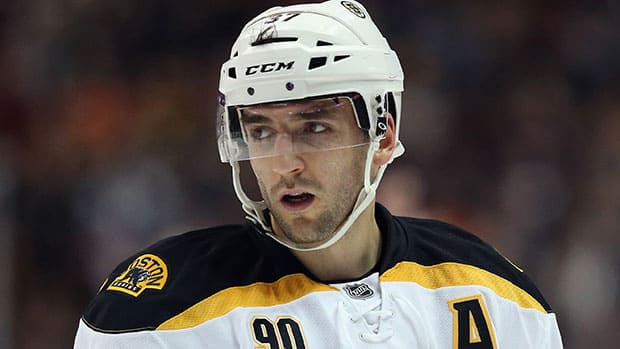 Patrice Bergeron's Boston Bruins are the oddsmakers' favourites to win the Cup,  and he's our pick for the Selke Trophy as the NHL's top defensive forward. (Jeff Gross/Getty Images)