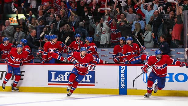 Rene Bourque (17), Daniel Briere (48) and P.K. Subban (76) leap off the bench to celebrate Montreal's series-clinching win. (Andre Ringuette/Getty Images)