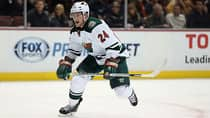 Wild forward Matt Cooke has earned a reputation for targeting opponents with dangerous hits. (Jeff Gross/Getty Images)