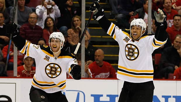 Boston's Jarome Iginla, right, celebrates his Game 4 overtime goal with teammate Dougie Hamilton. (Gregory Shamus/Getty Images)