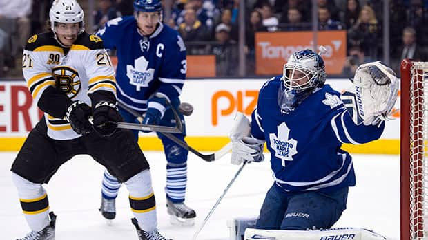 Toronto Maple Leafs goaltender James Reimer, right, made 10 of 11 saves in relief of Jonathan Bernier Thursday night against the Boston Bruins. (Frank Gunn/Canadian Press)