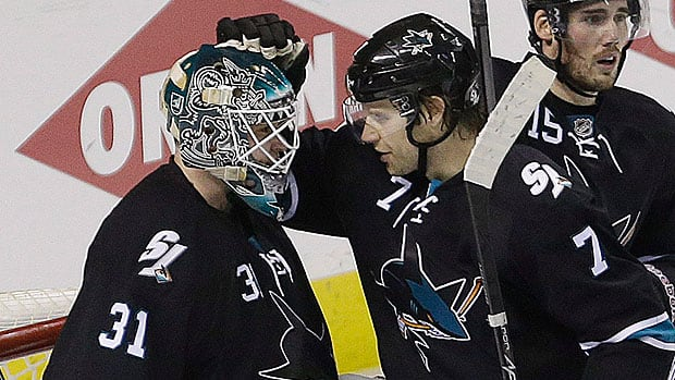 Sharks goalie Antti Niemi, left, was yanked for the second consecutive outing in Saturday's Game 6 after allowing three goals to the Kings. It's time, according to CBCSports.ca hockey writer Mike Brophy, for Niemi and his teammates to exorcise their playoff demons. (Ben Margot/Associated Press)