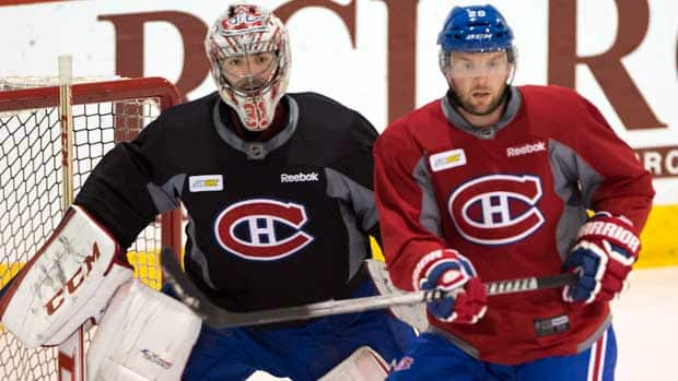 Montreal Canadiens goalie Carey Price and teammate Thomas Vanek follow the play in a practice session at Brossard, Que., on Monday. (Ryan Remiorz/Canadian Press)