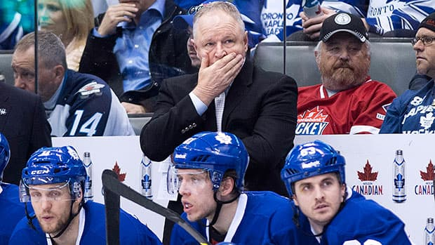 Head coach Randy Carlyle, top, and his Toronto Maple Leafs are one step closer to being eliminated from playoff contention.(Nathan Denette/Canadian Press)