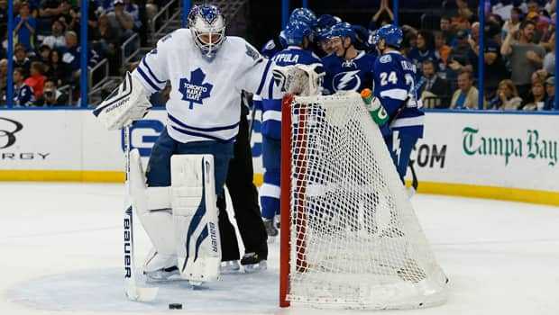 James Reimer (34) removes the puck from the net in a 3-0 loss at Tampa Bay that eliminated Toronto from playoff contention. (Mike Carlson/Getty Images)