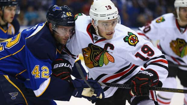 Jonathan Toews, right, and the Chicago Blackhawks can ill afford to fall behind 3-0 in their best-of-seven series to the St. Louis Blues. (Dilip Vishwanat/Getty Images)