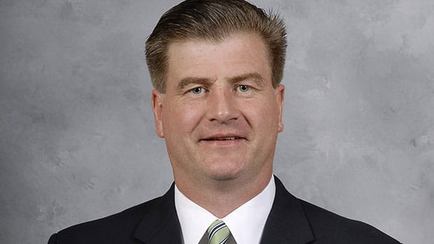 After earning front-office experience in Boston and Buffalo, Jim Benning will reportedly be named Vancouver's new GM on Friday. (Getty Images)
