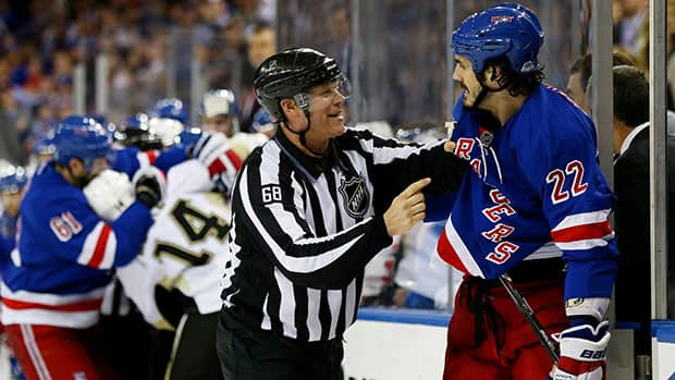 Perhaps to the relief of the Pittsburgh players on the ice, linesman Scott Driscoll kept mammoth Rangers forward Brian Boyle out of this scrap in Game 6. (Elsa/Getty Images)