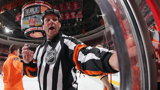 Hard-core hockey fans are familiar with veteran referees like Paul Devorski but the NHL prefers its officials remain anonymous. (Bruce Bennett/Getty Images)