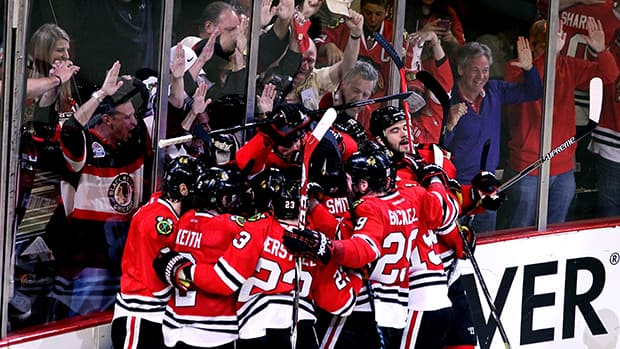 Somewhere in this pile of Blackhawks is Michal Handzus, who scored the game-winner in double overtime in Chicago on Wednesday. It was the ninth tally of Game 5 of the Western Conference final. (Tasos Katopodis/Getty Images)