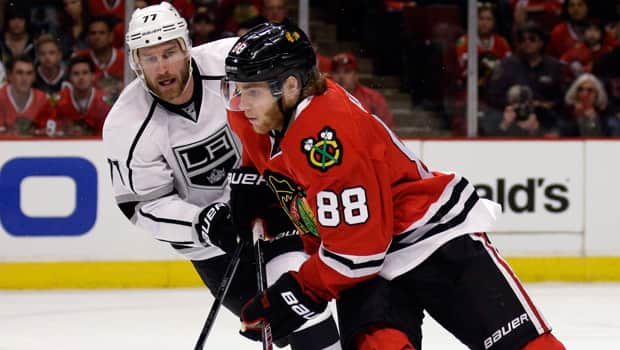 Patrick Kane (88) of the Chicago Blackhawks eludes Jeff Carter (77) of the Los Angeles Kings in the Western Conference final. (Nam Y. Huh/Associated Press)