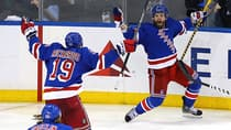 Martin St. Louis (26) of the New York Rangers celebrates with teammates after scoring the game winner in overtime against the Montreal Canadiens to win Game 4 of the Eastern Conference final on Sunday in New York City. The Rangers defeated the Canadiens 3-2. (Al Bello/Getty Images)