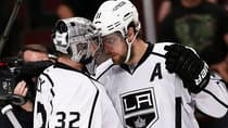 Goalie Jonathan Quick, left, whose key save kept the Kings in the contest, gets congratulated by teammate Anze Kopitar  after L.A. roared back for a 6-2 win in Game 2 in Chicago. (Jonathan Daniel/Getty Images)
