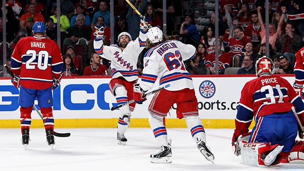 Martin St. Louis (26) of the New York Rangers celebrates with Carl Hagelin (62) after scoring a first period goal against the Montreal Canadiens in Game 1 of the Eastern Conference final on Saturday in Montreal. (Francois Laplante/Getty Images)