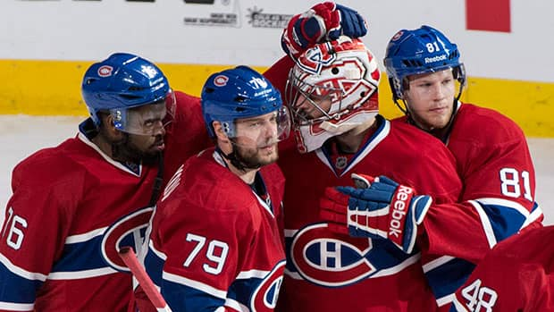 From left to right, Montreal Canadiens' P.K. Subban, Andrei Markov, Carey Price and Lars Eller celebrate their Game 6 victory over the Boston Bruins Monday night at the Bell Centre. (Paul Chiasson/Canadian Press)