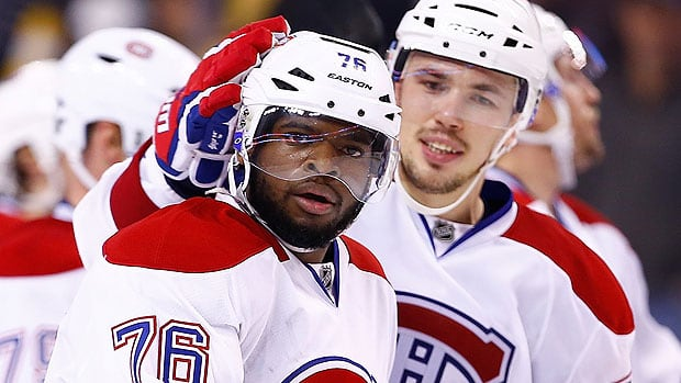 Canadiens defenceman P.K. Subban, left, has won some fans over by the way he handled being the subject of racial tweets after the first two games of Montreal's Round 2 playoff series against Boston. He's also standing out on the ice with two goals and nine points in six post-season games. (Jared Wickerham/Getty Images)