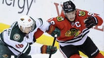 Chatty captain Jonathan Toews, right, and the Stanley Cup champion Blackhawks will try to get past Jared Spurgeon and the Wild in the second round. (Hannah Foslien/Getty Images)