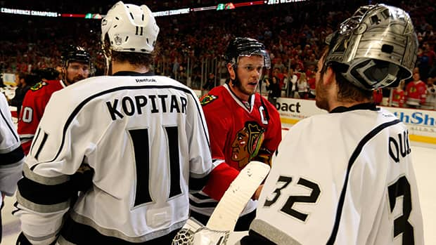 Jonathan Toews, centre, of the Chicago Blackhawks is congratulated by Anze Kopitar and goalie Jonathan Quick of the Los Angeles Kings after the Blackhawks ousted the Kings in Game Five of the 2013 Western Conference final. The two teams will meet in a rematch of that series starting Sunday. (Gregory Shamus/Getty Images)