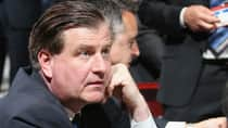 Vancouver Canucks rookie general manager Jim Benning ponders his next move in the first round of the NHL draft on Friday. (Bruce Bennett/Getty Images)
