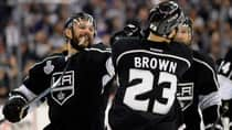 Kings captain Dustin Brown (23) celebrates his double overtime goal in Game 2 against the Rangers with teammate Alec Martinez on Saturday night. (Harry How/Getty Images)
