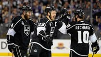 Dustin Brown (23) celebrates with his Los Angeles Kings teammates after he scored in double overtime against the New York Rangers during Game 2 on Saturday in Los Angeles, California. (Harry How/Getty Images)