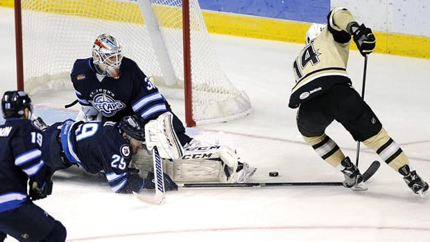 IceCaps netminder Michael Hutchinson (33) impressed in the AHL playoffs, going 12-9 with a 1.95 GAA and three shutouts. (Mark Moran/Associated Press)