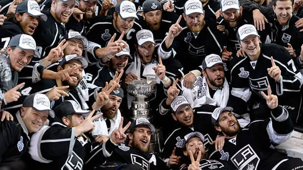 The Kings posed for the traditional championship photo after winning their second Stanley Cup in three years. (Harry How/Getty Images)