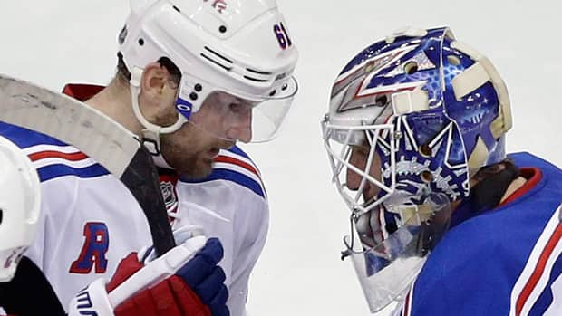 New York Rangers' Rick Nash, left, and goalie Henrik Lundqvist, right, are two key players if their team is to get back in the Stanley Cup final series against the L.A. Kings. (Mel Evans/Associated Press)