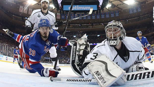 Forward Chris Kreider, left, and the Rangers will have to solve Kings goalie Jonathan Quick if they hope to extend the Stanley Cup final. (Bruce Bennett/Associated Press)