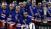 The Rangers posed with, but were careful not to touch, the Prince of Wales Trophy after winning the Eastern Conference title. (Bruce Bennett/Getty Images)
