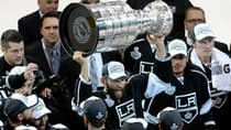 Los Angeles Kings defenceman Robyn Regehr whoops it up as he hoists the Stanley Cup at Staples Center on June 13, 2014. (Kevork Djansezian/Getty Images)