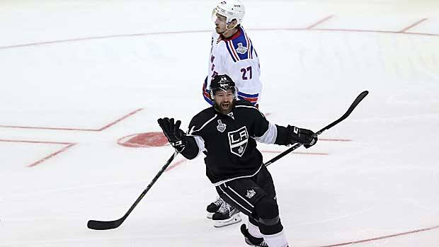 Justin Williams reacts to his game winner in overtime Wednesday at Staples Center, as Ryan McDonagh of the New York Rangers can only rue the team's missed chances. (Victor Decolongon/Getty Images)