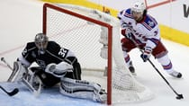 Jonathan Quick (32) and the Los Angeles Kings can finish off Mats Zuccarello and the New York Rangers once and for all with a win in Friday's Game 5 of the Stanley Cup final at Staples Center on Hockey Night in Canada. (Bruce Bennett/Getty Images)