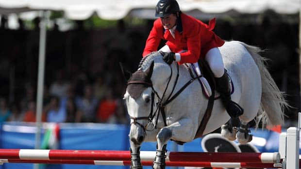 McLain Ward of USA rides during the Equestrian Individual Jumping Finals during Day 15 of the XVI Pan American Games.  (Dennis Grombkowski/Getty Images)