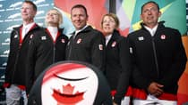 Olympic show jumpers Ian Millar, left to right, Tiffany Foster, Eric Lamaze, Jill Henselwood and Yann Candele pose for photographers at Spruce Meadows on Thursday. (Jeff McIntosh/Canadian Press)