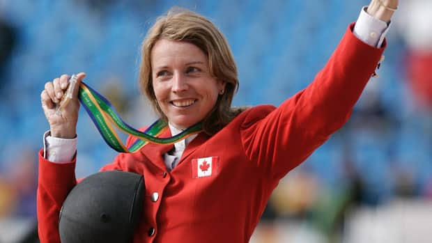 Canada's Jill Henselwood and horse George were named to the Olympic Show Jumping Team that will travel to London for the 2012 Olympics. (AP Photo/Victor R. Caivano)