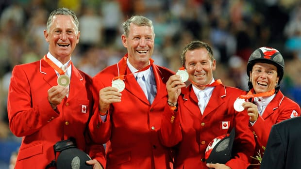 From left, Mac Cone, Ian Millar, Eric Lamaze and Jill Henselwood, gave Canada the silver medal win in the equestrian team show jumping competition at the Beijing 2008 Olympics. (AP Photo/Susan Walsh)