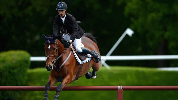 Richard Spooner, seen here at the Global Champions Tour Grand Prix of Hamburg on May 17, 2012, was one of three riders with a clean round in the Cenovus Derby at Spruce Meadows. (Dennis Grombkowski/Bongarts/Getty Images)